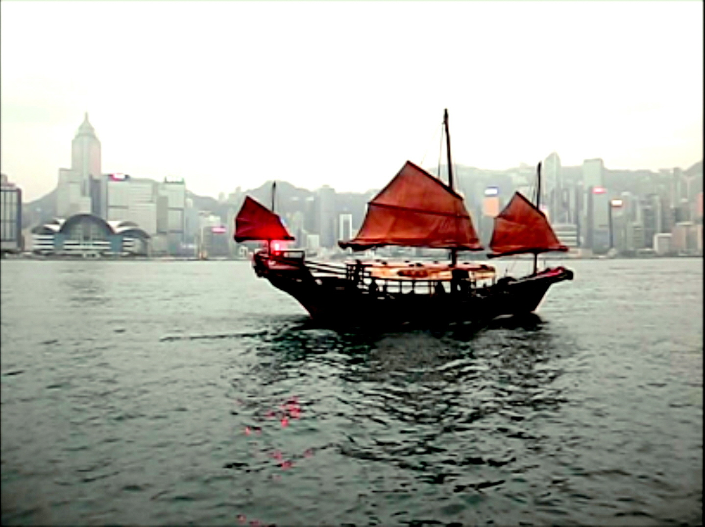 Old Fashioned Junk in Harbor - Hong Kong Skyline (Still taken from Video)