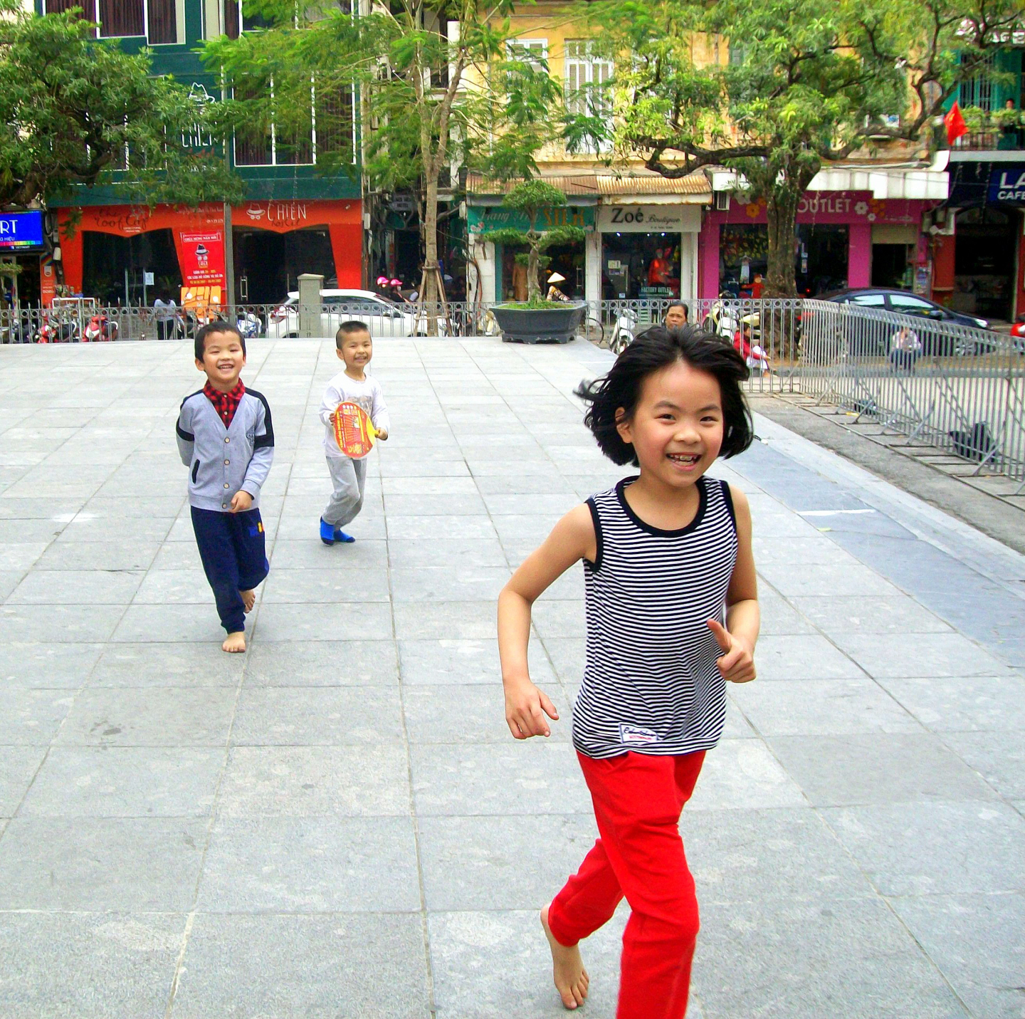 Children Playing on Cathedral Front Steps in Hanoi, VIet Nam